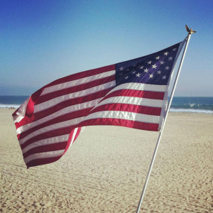 4th of July flag on beach